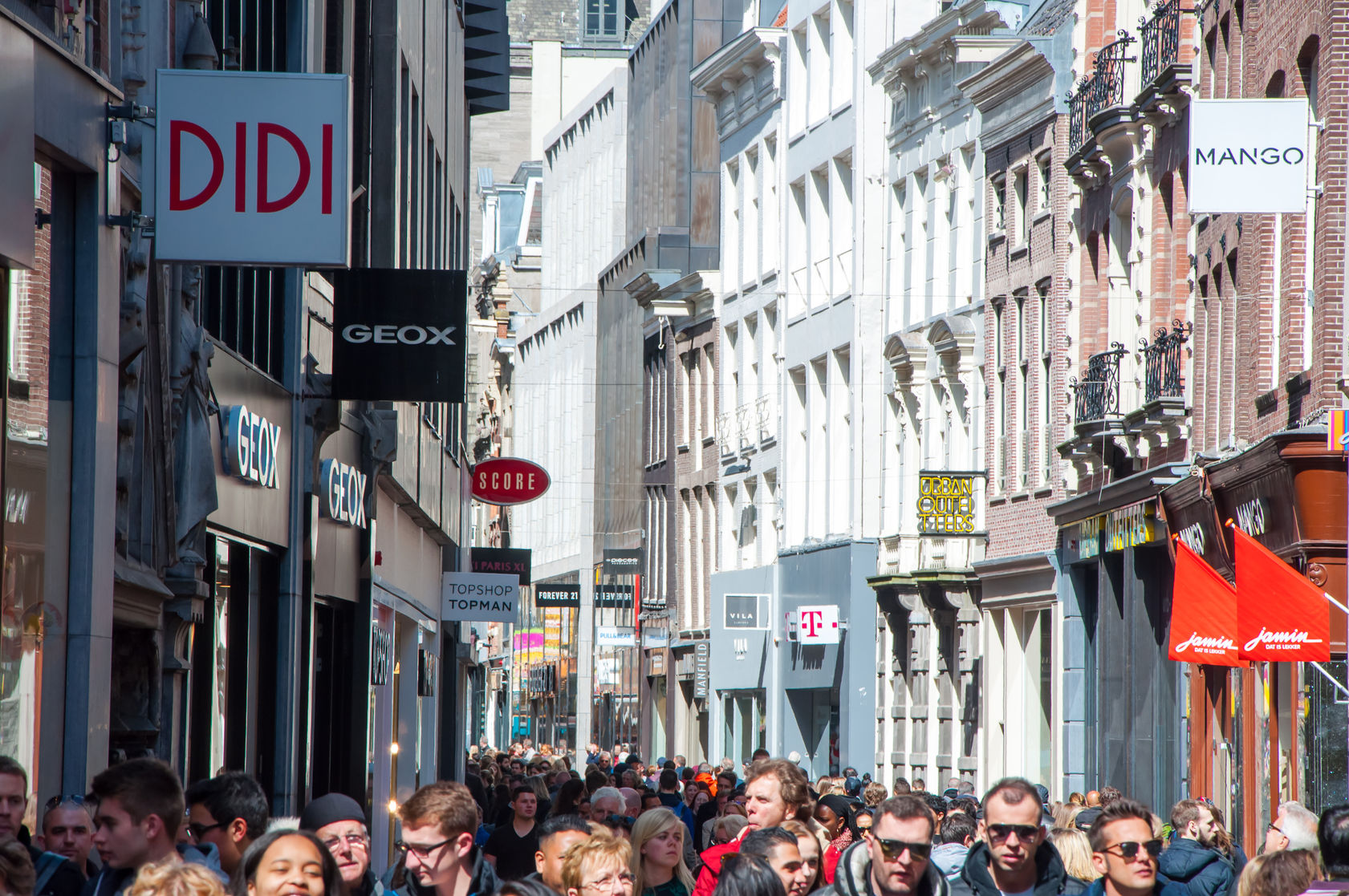 45638765 - amsterdam-april 30: shopping on kalverstraat street on april 30,2015, the netherlands. the kalverstraat is a busy shopping street of amsterdam, the capital of the netherlands.